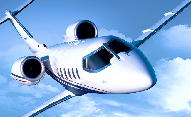 biz jet over the clouds for an aircraft appraisal